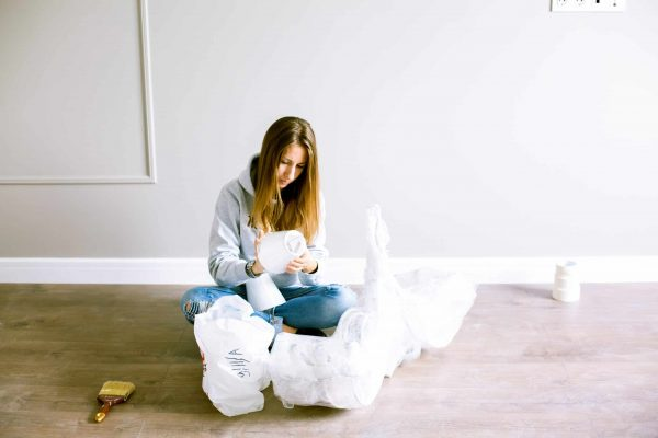 woman sitting down unpacking lamps