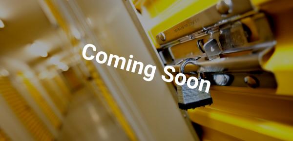 Self Storage corridor with padlock and yellow doors