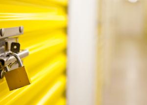 Padlock on yellow storage units