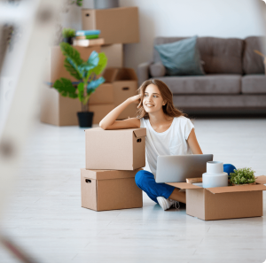 Lady leaning on Boxes