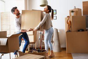 man and woman lifting heavy box
